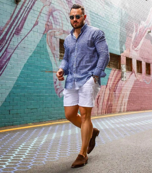 Brown suede penny loafers worn casual with shorts