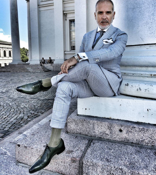 Suited Traveller wearing Thomas Bird green wholecuts with a pale blue windowpane suit