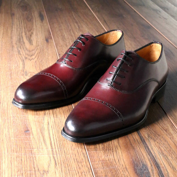 Oxblood cap toe oxford shoe
