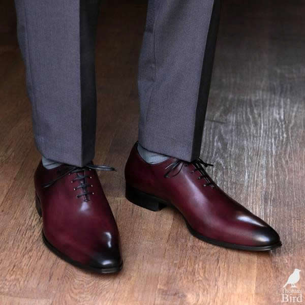 Oxblood wholecut shoes with grey suit