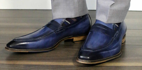 Blue penny loafers with light grey suit