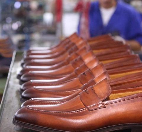 Penny loafers being made in a factory in Italy