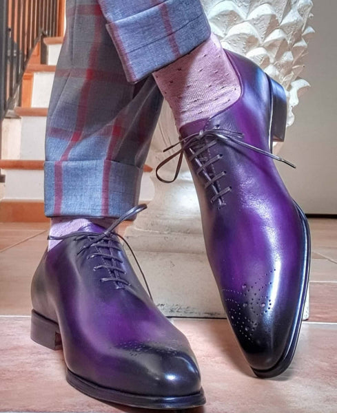 Suited Traveller wearing Thomas Bird custom purple wholecuts with medallion toe