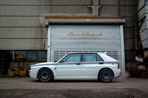 Lancia Delta HF integrale with the exclusive Speedshop.ch Martini 6.5 livery giving the car a sleek and nice look
