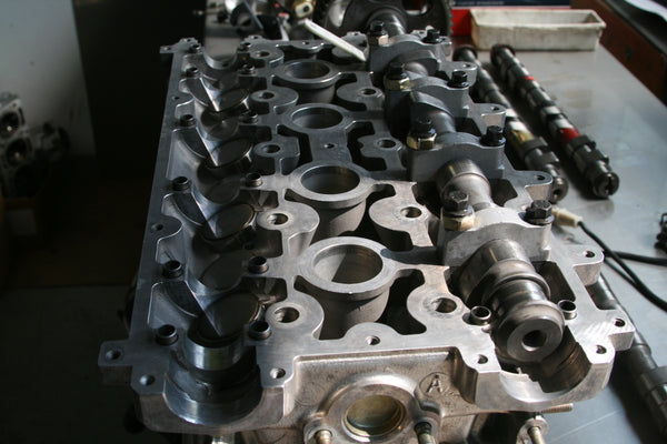 CNC machined Cylinder Head for Lancia Delta HF integrale. Blueprinted and ported flowbench tested for maximum Volumetric Efficiency. Bespoke intake and exhaust camshaft kit.