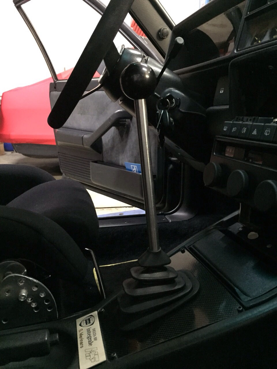 Lancia Delta HF integrale Short Shifter Kit installed with carbon plate