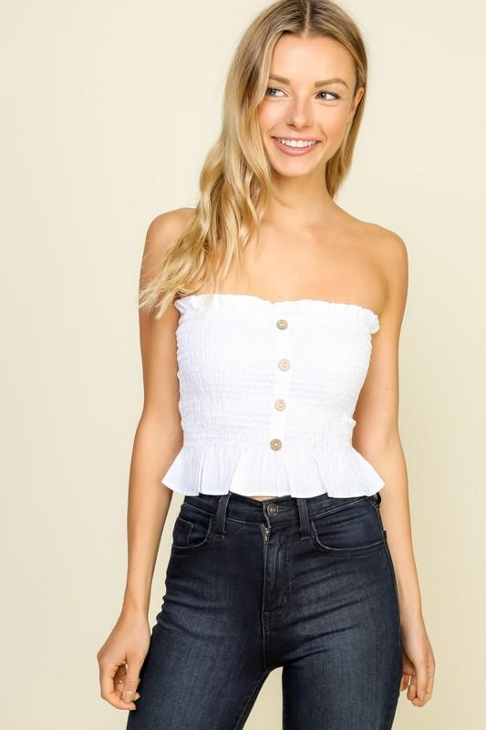 Strapless smocking crop top. Tube top in white with ruffle top and bottom hem. Four buttons down the center. Smocked body sleeveless top in white.
