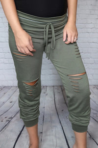 Olive Distressed High Waisted Joggers Elastic Waist Faux Drawstring Cuffed Ankles Relaxed Fit True to Size 87% Polyester, 9% Rayon, 4% Spandex