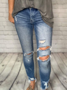 High waisted Kan Can Jeans with medium light wash. Front distressing, soft & stretchy. Raw frayed ankles.