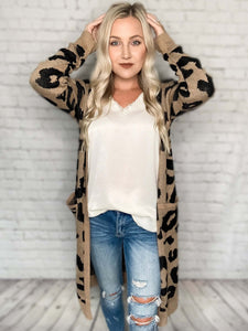 The animal print trend is hot this year & we couldn't be more excited about it! Make a statement wearing this leopard print cardigan into fall and winter. This long duster cardigan is perfect for those chilly months. You can wear this leopard print statement piece over a black or white tank & pair it with jeans or leggings - you can't go wrong. PS - this cardigan has pockets!  Leopard Animal Print Taupe Color Duster Cardigan Pockets 100% Acrylic