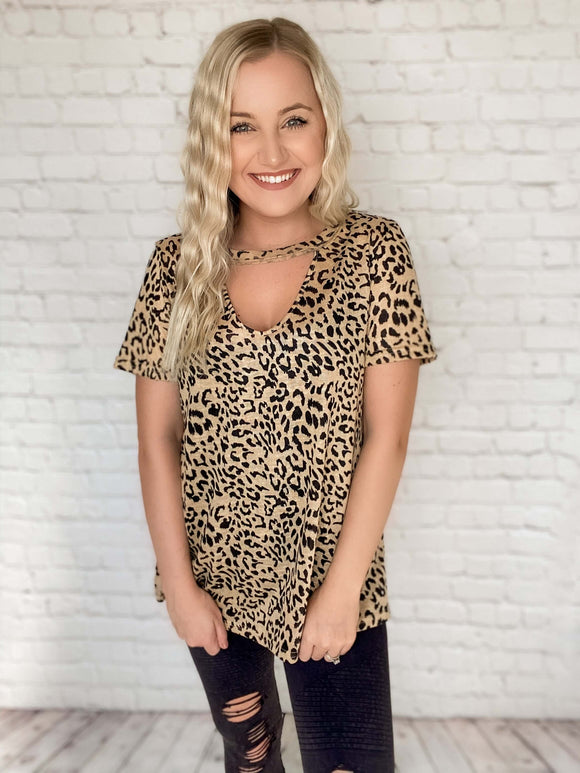 This animal print short sleeve tee is so chic & stylish! You can wear it so many different ways! Pair it with leggings & slip ons or dress it up with black jeans. Don't forget to snag our black denim jacket to wear over this tee as we transition into Spring weather. This leopard print t-shirt features a keyhole cutout, a v-neckline, side slits and fits true to size.  Leopard Print V-Neck Keyhole Cutout Side Slits True to Size 100% Polyester