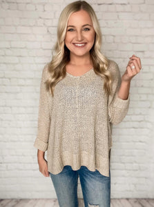 Your new go to sweater for Spring is here! This lightweight sweater can be worn so many different ways. We love to wear it off the shoulder with one of our bralettes and a pair of Kan Can jeans for an effortless look. This lightweight oatmeal colored knit sweater features a crew neck, 3/4 sleeves and has a loose fit.  Oatmeal Lightweight Sweater Crew Neck Loose Fit Side Slits 65% Acrylic, 35% Nylon