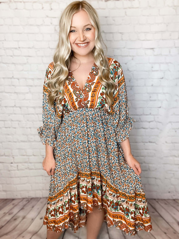 Mustard Boho Floral Paisley Tiered High-Low Midi Dress Double V-Neck Elastic Ruffle Sleeves Elastic Waist Tie Back Detail Relaxed Flowy Fit True to Size 100% Rayon