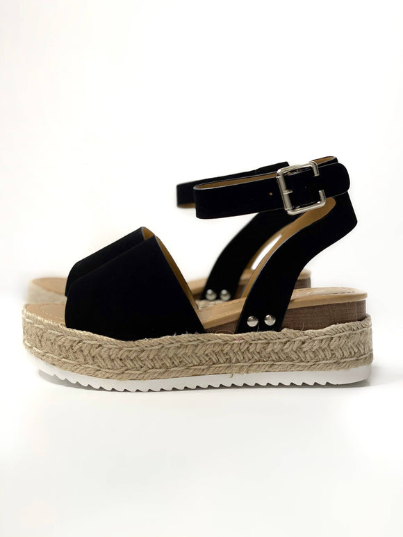 These espadrille sandals are trendy and chic and feature a jute platform wedge. They can be dressed up or down so you can pair them with anything. Not only are they comfy, but they're cute! These will be your everyday go to sandals this spring.  Black Espadrille Platform Sandal Wrap Ankle Strap Buckle Closure 2 Inch Platform Height Fits True to Size