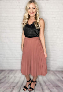 This skirt is such a chic way to dress up an outfit! This pleated mauve skirt paired with our satin lace cami tank makes for the perfect Valentines Day outfit and will help you transition into Spring flawlessly! This pleated skirt features an elastic waistband for all day comfort, a gorgeous mauve color and can be worn as a midi or maxi skirt depending on your height. This skirt also comes in black.  Mauve Pleated Skirt Elastic Waistband 96% Polyester, 4% Spandex