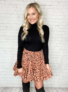 How sassy is this skirt?! OBSESSED. This little ruffle skirt has all the must have details. This geometric print mini skirt is lined with shorts, has an elastic drawstring waist, is lightweight and non-sheer. Pair this ruffle skirt with our black turtleneck top and a pair of over the knee boots for an effortless look.  Brown and Black Geometric Print Ruffle Skirt Lined with Shorts Drawstring Elastic Waist Non-Sheer Woven Lightweight 100% Polyester