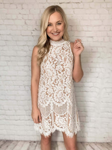 This lace dress is the perfect outfit for a bride-to-be! This white colored dress features lace throughout with a nude lining underneath, scallop hem detail and a keyhole button closure in the back. You can pair this romper with wedges for an even dressier look or pair it with sandals to dress it down a bit. This is the perfect bridal dress to wear to your bridal shower or rehearsal dinner!