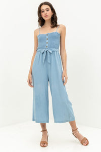 Smocked Flare Leg Jumpsuit with Waist Tie and Buttons in Light Blue