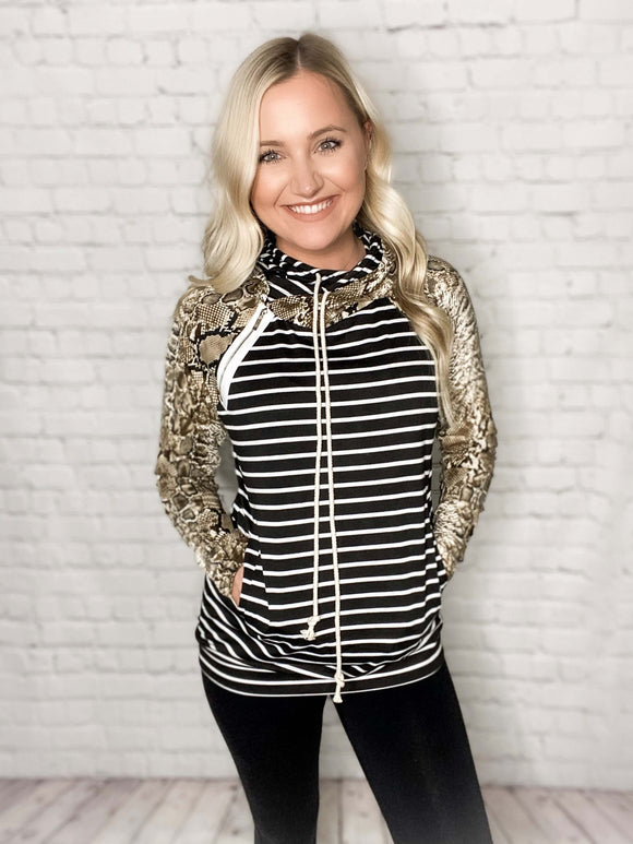 This snakeskin striped hoodie is so stylish! You'll stay comfy and cozy all winter long while wearing this hoodie AND you'll look chic. This hoodie features a double hood (one striped and one snakeskin print), draw strings, a side zipper at the top, two side pockets and the perfect mix of snakeskin print and stripes.   Black/White Stripes & Snakeskin Print Hoodie Double Hood Side Zipper Detail Two Pockets Drawstrings True to size 95% Polyester, 5% Spandex