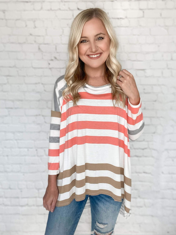Stripes are hot this season & we're loving it! This striped loose fit top is going to be your new favorite go to top. It features fitted sleeves, multi color stripes and a loose fit on the body. Throw this top on for an effortless look.  Striped Multi Color Coral, Grey, Taupe, White Loose Fit True to Size 62% Polyester, 33% Rayon, 5% Spandex Made in the USA