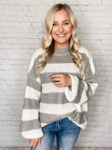 This oversized striped sweater is so cute! Tuck the front of it into some jeans or rock it with a pair of our leggings - you can't go wrong either way. This grey and white sweater features an oversized slouchy fit, bubble sleeves and a crew neckline.  Grey/White Striped Bubble Sweater Crew Neck Oversized Slouchy Fit 100% Acrylic