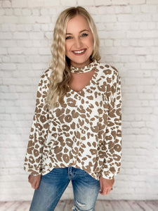 The leopard print fashion trend is so hot right now that we just had to have this top! This tan leopard print pattern is so trendy and it's neutral color makes it super easy to style. Tuck it into the front of jeans, wear it with leggings, knot it.. so many options! This long sleeve top features balloon sleeves, cut out keyhole detail, choker v-neck and has a loose/oversized fit.  Tan Leopard Print Long Balloon Sleeves Cut Out Keyhole Choker V-Neck Oversized/Loose Fit