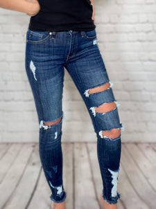 "Mid Rise Kan Can Skinny Jeans Front Distressing Dark Wash Raw Frayed Ankles True to Size 65.4% Cotton, 33.6% Polyester, 1% Spandex 8.5"" Front Rise, 27"" Inseam"