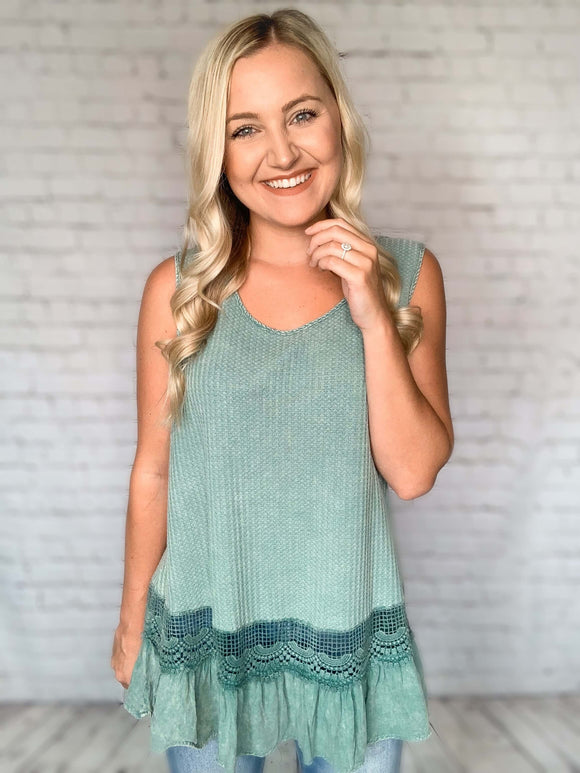 If you loved our waffle button up shirts, you're going to love this waffle tank! It features lace detailing in the back with a keyhole closure, gorgeous crochet detail and a ruffle hem for that perfect boho look. You'll be so comfy in this relaxed fit! Wear this tank to dress up a pair of skinny jeans.     Dusty Mint Waffle Knit Tank Top Lace Back Keyhole Closure Crochet Ruffle Trim Flowy fit Sleeveless Tank Solid Sheer Lace Back/Crochet Hem