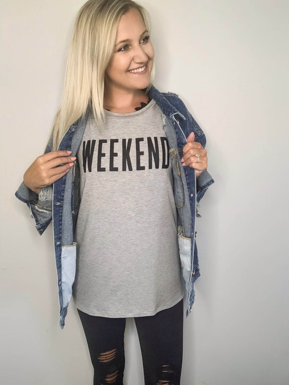 This weekend graphic tee needs added to your closet ASAP! Celebrate every weekend in style wearing this graphic top. Pair it with our distressed moto jeggings for that cute and comfy look or spice it up with our oversized denim jacket!  Heather Grey Graphic Tee WEEKEND Graphic True to Size Made in USA 95% Rayon, 5% Spandex Brooke is 5'4 wearing size small.