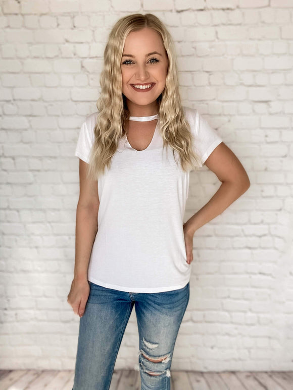 This white tee is a wardrobe essential! It makes for the perfect layering top to wear under all of your kimonos and cardigans this Spring! This white basic t-shirt has a fun twist to it - it features a raw hem keyhole cutout, a super stretchy and soft material and it's lightweight so it's comfortable to wear.   White Keyhole Raw Hem Cut Out Stretchy True to Size 95% Cotton, 5% Spandex