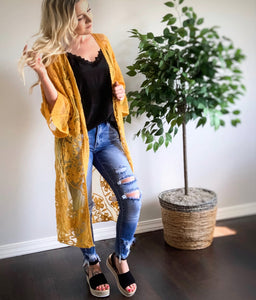 Duster lace kimono in mustard color. Features an open front, wide sleeves & sheer lace detail throughout.