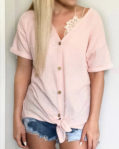 "These waffle knits are going to be your new favorite summer basic. They're lightweight and oh so comfy. The rolled sleeves and front tie knot give it such a chic look. You can even wear this top off the shoulder with a bralette!   Blush Thermal Waffle Knit Short Sleeve Self Tying Front Knot Button-Up Rolled Sleeves Stretchy Material True to Size 87% Polyester, 10% Rayon, 3% Spandex 9.5"" Rise, 3"" Inseam Brooke is 5'4 and is wearing a size small. Styled with our bralettes. This top is also available in sage."