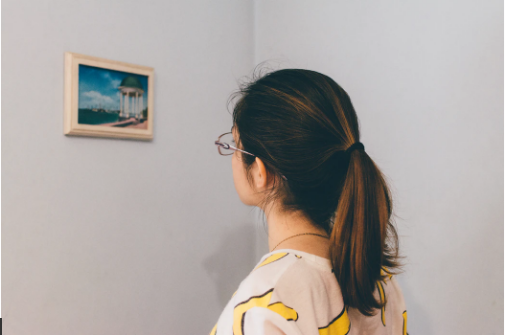 woman looking at wall art