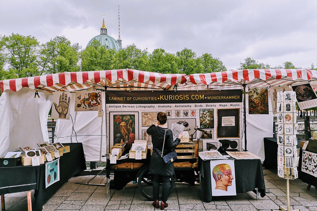 Curious people looking for curiosities! Our market stand is located directly next to Under den Linden, across from Lustgarten, near the Café at the German History Museum