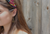 Fashion blogger in gold star earrings and cute colorful headband