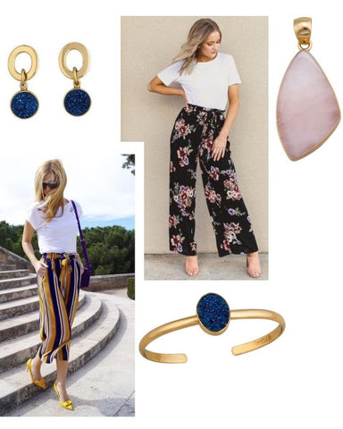 Earrings, gold cuff, and a pendant with printed pants and a white t-shirt