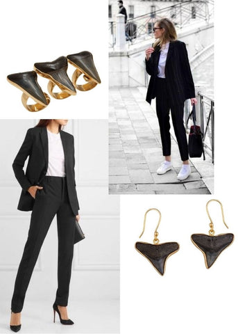 Black earrings and rings, with white t-shirts and black pants