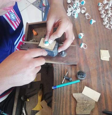 Our Metalsmith in Taxco, Mexico setting a Turquoise nugget into our adjustable Sterling Silver Rings