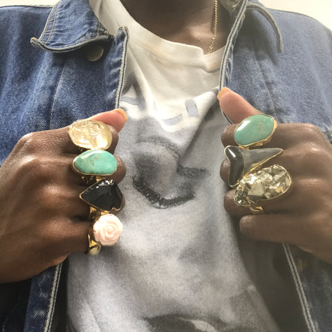 Fashion blogger in denim jacket poses in Mother of Pearl and Obsidian Knuckle Rings