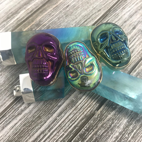 Sterling Silver Titanium treated quartz pendants with shiny purple and blue skull rings