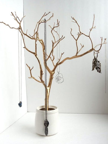 Gold painted tree jewelry organizer for eye-catching interior design
