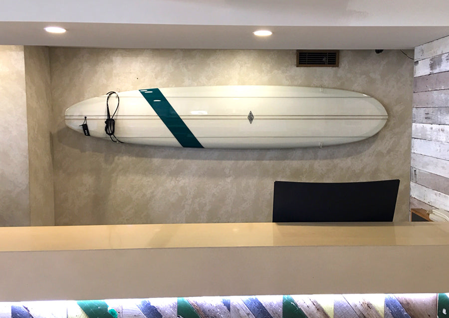 Surfboard in racks behind reception