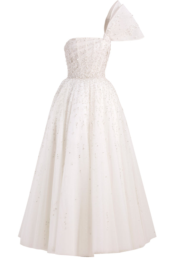 Short fully beaded	tulle	dress with draping	 and	a bow on	the shoulder