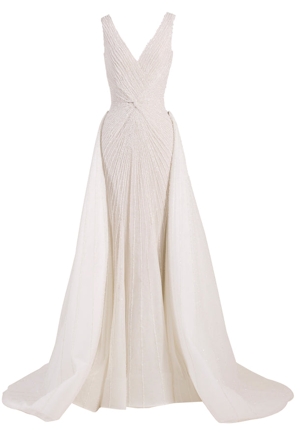 Long sleeveless fully beaded tight dress, with a wide neckline.