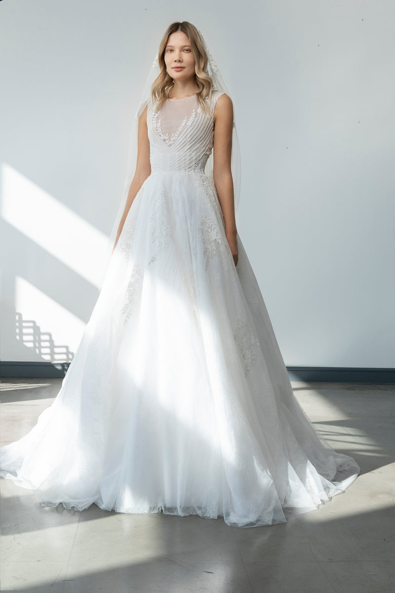 Long sleeveless fully beaded tulle dress, with a round neckline.