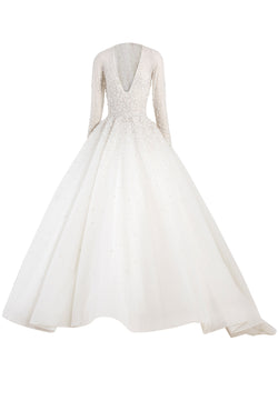Long beaded tulle dress with tulle beaded raglan sleeves and a wide neckline.