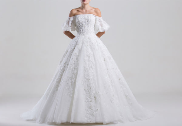 Long off shoulder fully beaded tulle dress, with short wide sleeves.