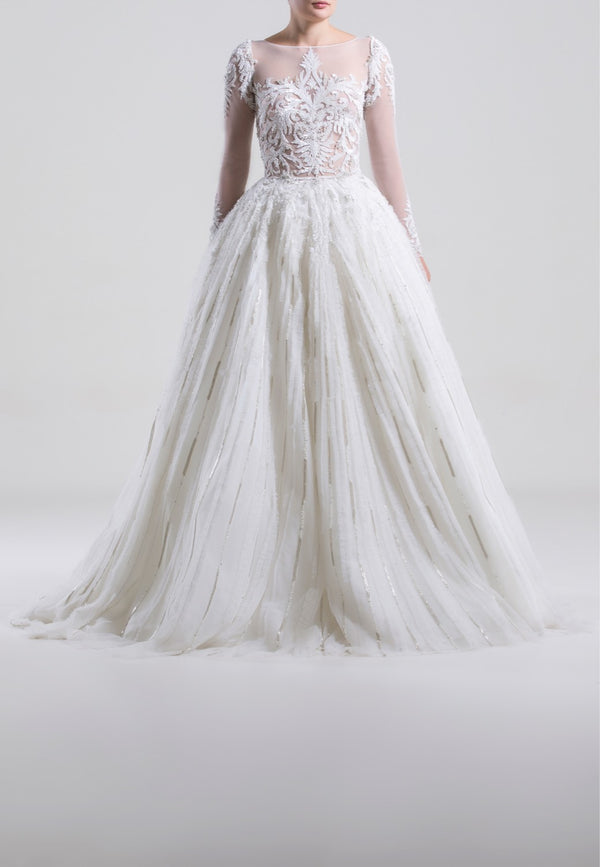 Long fully beaded tulle dress with tight beaded tulle sleeves; beading starting on top and spreading as lines.