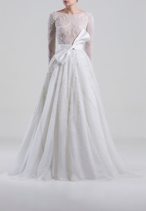 Long fully beaded tulle dress with tight beaded sleeves and an off-white Mikado bow on the waist.