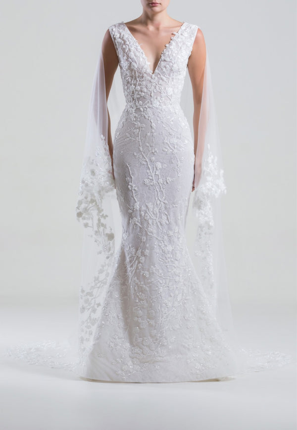 Long sleeveless fully beaded tulle dress with a built in veil and a wide neckline.